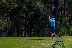 Golfer completes a swing