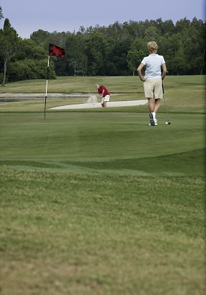 Couple playing on the greens