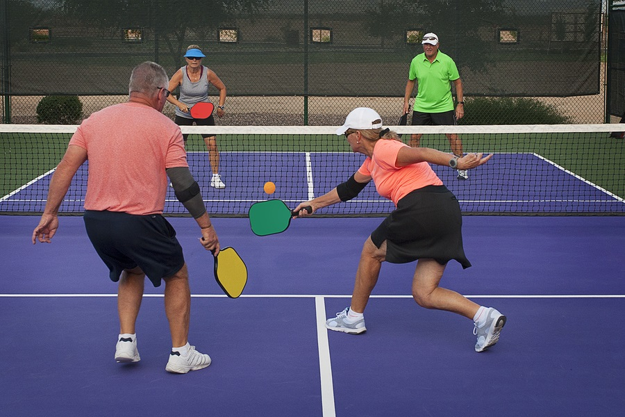 Couples playing pickleball